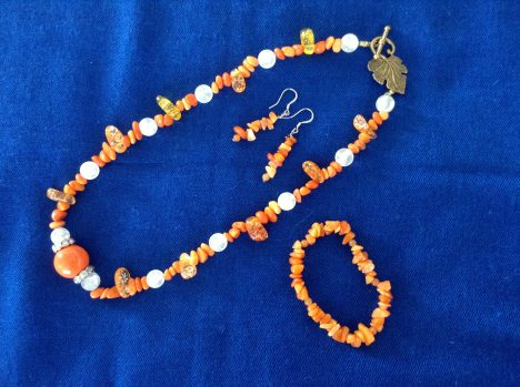 Coral necklace, bracelet and earrings: